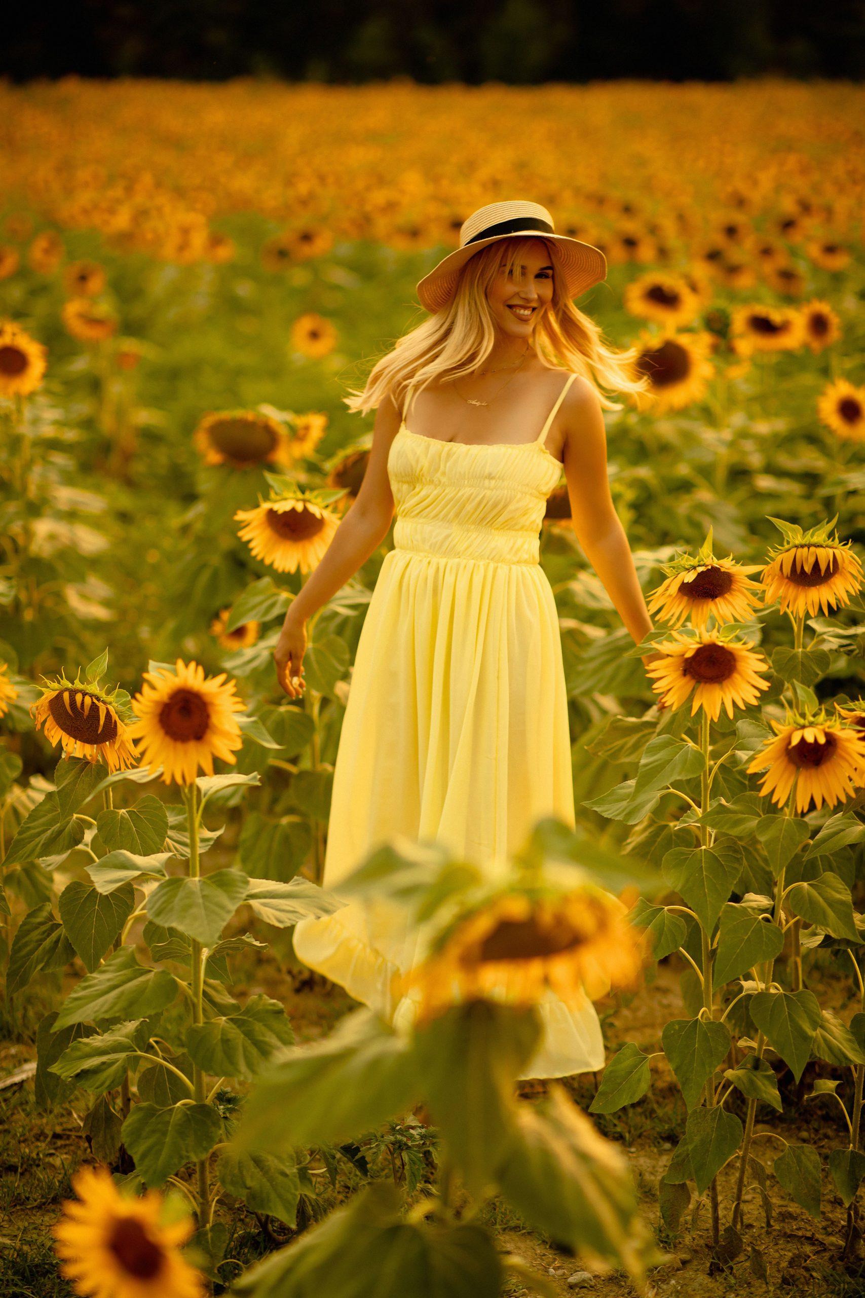 Beautiful girl twirling in nature